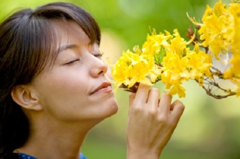 Stress_Relief.jpg photo od Woman smelling Flowers