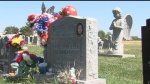 .jpg photo of grave of Child killed by child abuse
