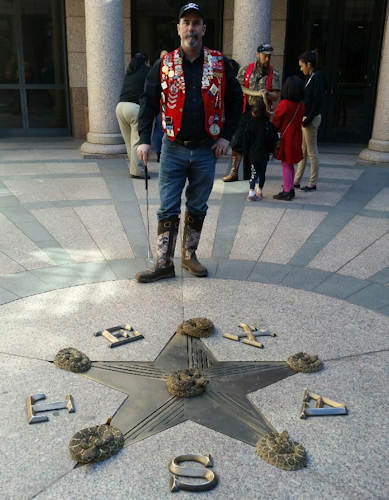 .jpg photo  of snake handler at Texas State Capitol