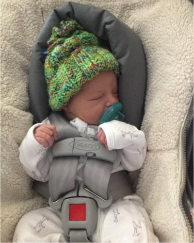.jpg photo of Child asleep in carseat