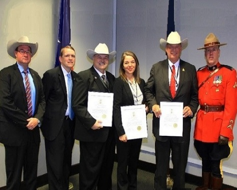 .jpg photo of Texas Attorney General's Law Enforcement Officers receiving Award from Royal Canadian Mounted Police